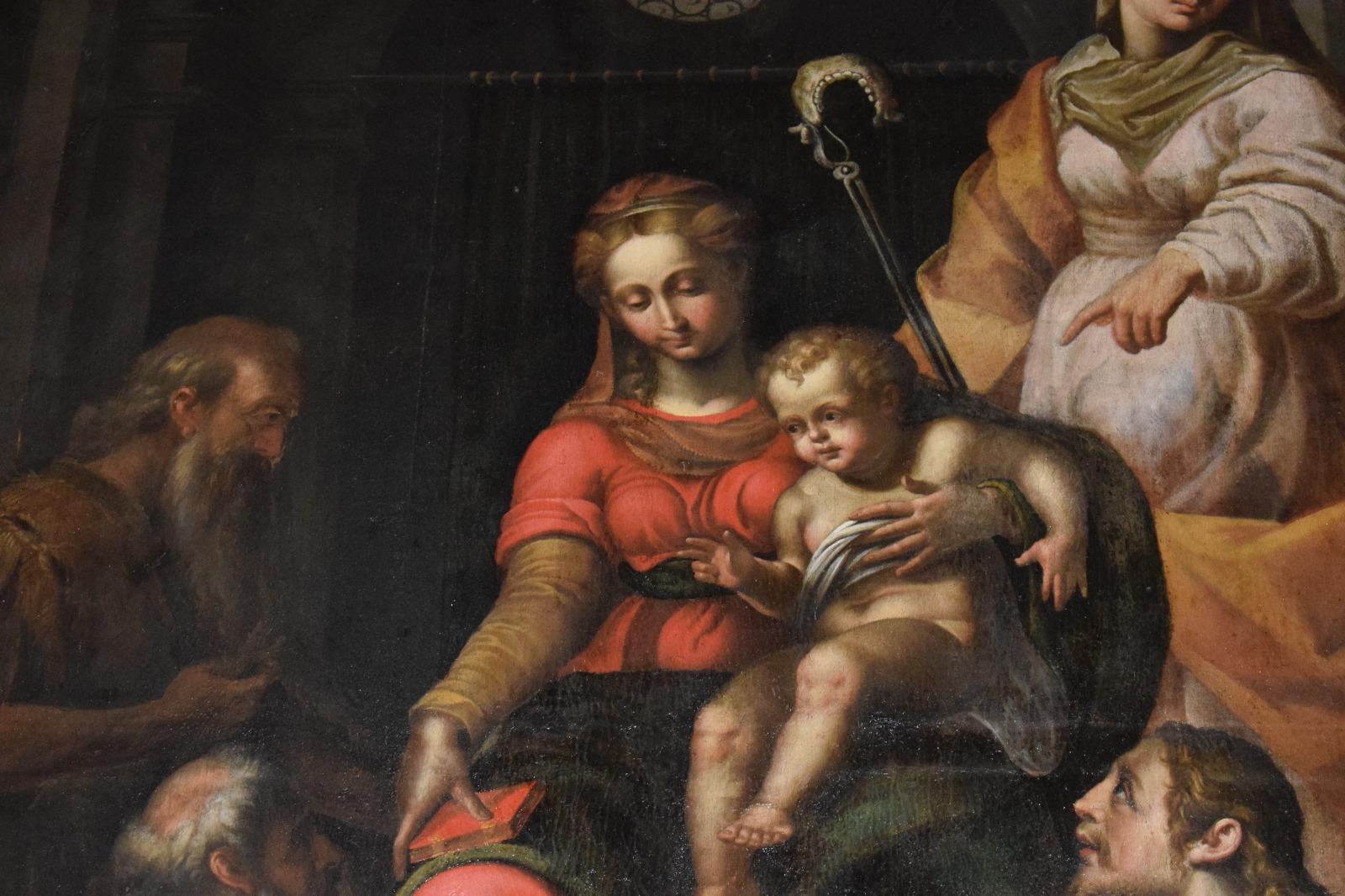Presentazione dipinto Madonna in trono con santi (15)