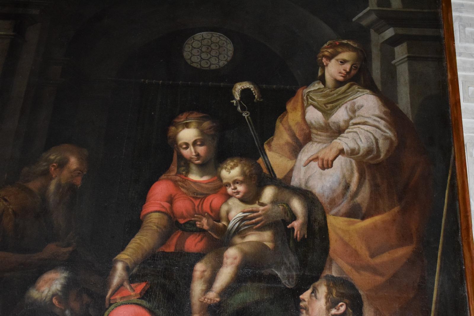 Presentazione dipinto Madonna in trono con santi (16)