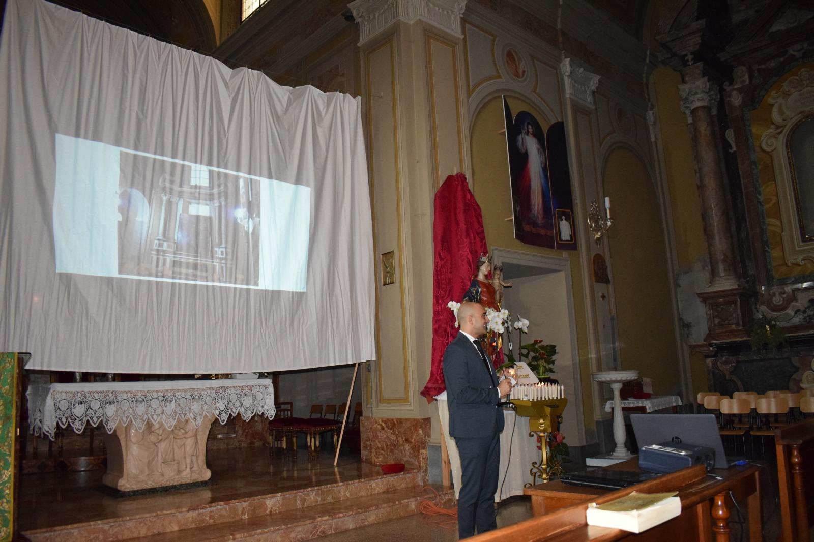 Presentazione dipinto Madonna in trono con santi (9)