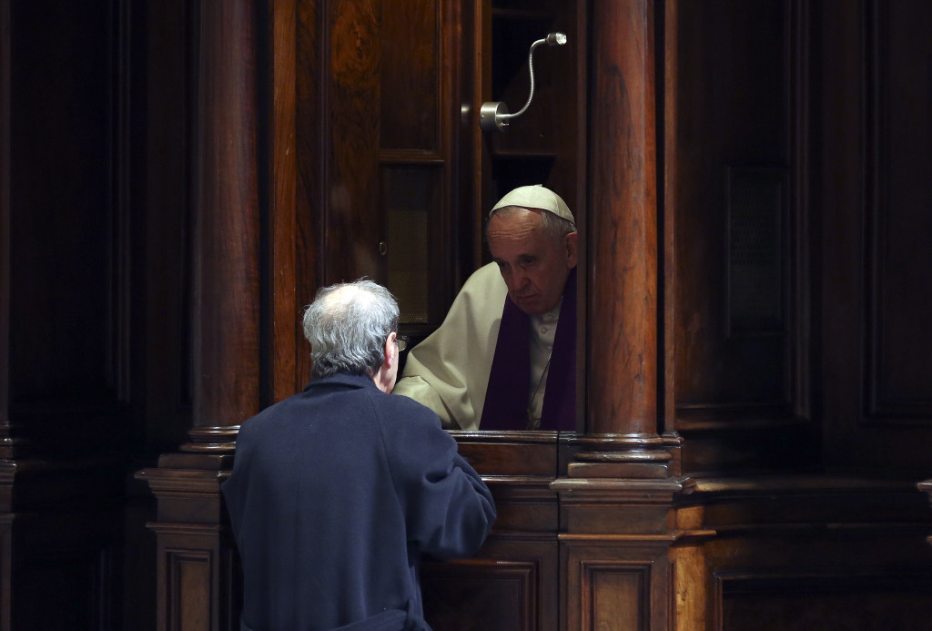 Pope Francis gives confession during the penitential celebration in St. Peter's Basilica at the Vatican, on March 13, 2015. Pope Francis declared an extraordinary jubilee year to celebrate the 50th anniversary of a landmark Vatican council and said the Church was bound to continue its reforming work. The year will be dedicated to the theme of mercy and begin on December 8th, the date the Vatican II council closed in 1965, Francis said in St Peter's cathedral on the second anniversary of his election as pope.   AFP PHOTO POOL / ALESSANDRO BIANCHI